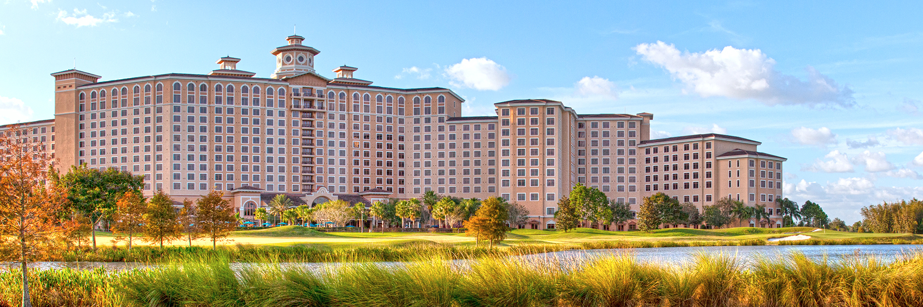 Exterior view of Rosen Shingle Creek hotel with golf course in foreground